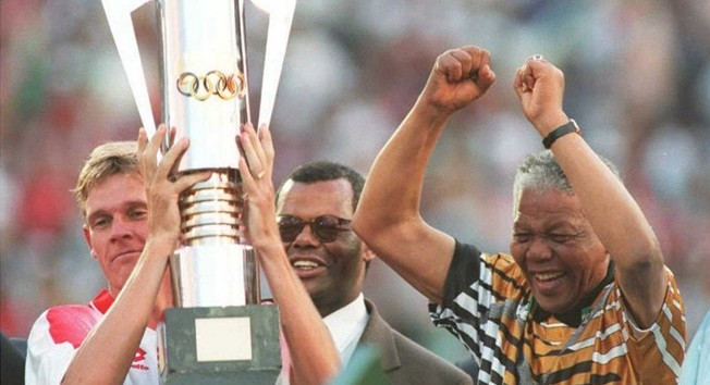 Nelson Mandela and Neil Tovey celebrate winning the 1996 African Cup of Nations