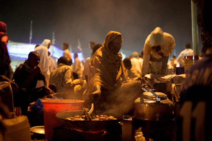 A Sudanese lady fries doughnuts during celebrations for Mawlid.