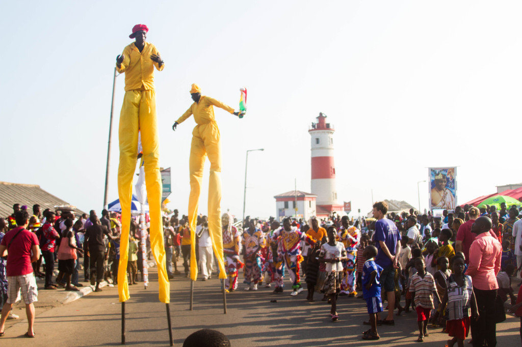 Stilt walkers and the lighthouse. Photo by Selorm Jay